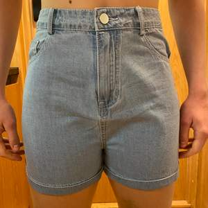 Brand new shorts, never worn, good quality, cute pocket detail, light wash denim colour, size M but fits S-XS.