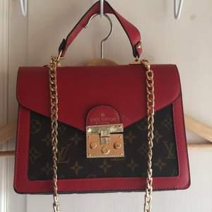 En Louis Vuitton  väska, köpt i Spanien som A kopia. Bra skick. Pris kan diskuteras vid snabb affär
