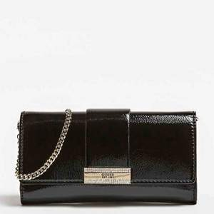 Brand New Guess clutch with tags and dustbag