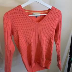 En kabelstickad tröja från Hampton republic