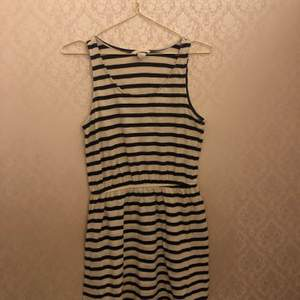 A white summer dress with black stripes, brand new. Have never been used it's in great condition, no flaws or problems. Very cute for the summer or spring, runs pretty big