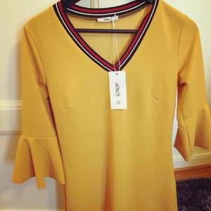 Spring beautiful yellow dress by Hailys.New with tags size 36