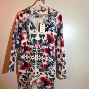 Oanvänd klänning, köparen står för frakten 55kr