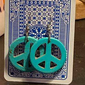 """turquoise, """"hippie"""" peace earrings i bought in greece but never wore :( I love them tho they are so cute. They are about the size of a mer bottle cap."""