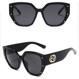 GG  solglasögon  ( EJ ÄKTA )  NYA