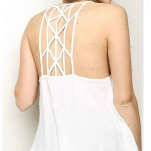 Super rare Brandy!! Sold out! **WILL BE STEAMED PRIOR TO SHIPPING.** Soft woven tank in sheer white with a deep v-neck front with cross strap detailing and a crisscross straps on the back. Shirttail hem. Polyester Elastane blend. Tag size OSFA
