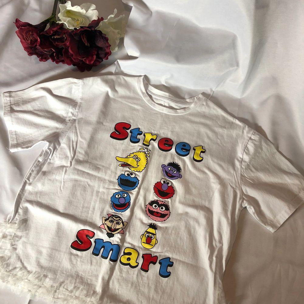 Oanvänd . T-shirts.