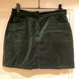 Dark green mini skirt from Weekday. Velvet fabrik. Selling because too small but in good shape.