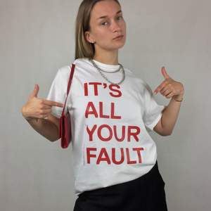 """""""IT'S ALL YOUR FAULT, a feel bad t-shirt by Lars Fuhre, 2014""""  This super dope t-shirt is like new! From Gildan Ultra Cotton, size M. No return nor refund. Free shipping everywhere in Sweden."""