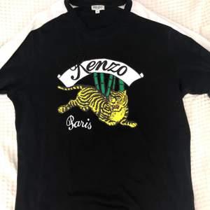 Kenzo T-shirt i storlek M, ej använd, hör av dig om du undrar något