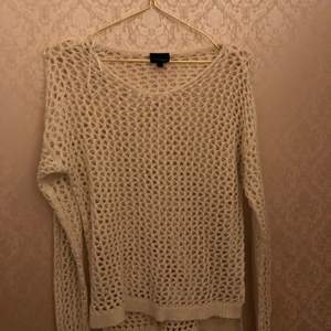 A Beige vintage top with holes in it that you can have over a short sleeve top or anything, it's very comfortable and runs big, it's in good condition and has no flaws. It's from lindex from the kids section but the don't sale it anymore.