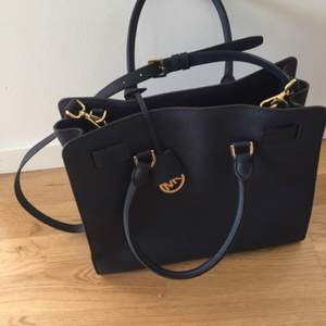 Blue leather handbag.