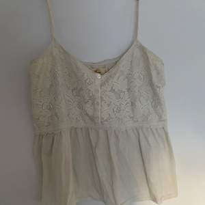 Vit linne från Hollister i storlek L