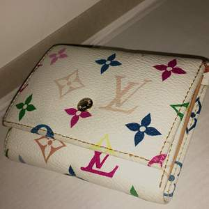 white with colored print Louis Vuitton wallet. Contact for more details.