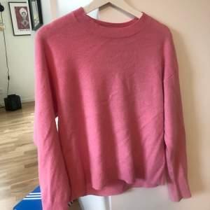 Rosa stickad tröja från WERA, pyttelite noppig