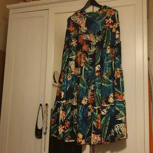 Its a beautiful floral skirt with a half top. It fits great for summer. I have only won it once so it is still in its good condition as new. free size for small and medium.