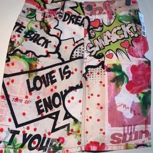 Pop art denim skirt. UK Size 8.