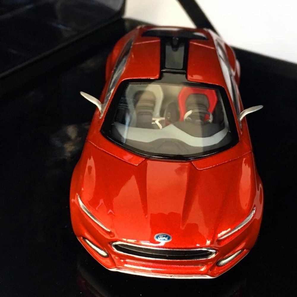 2012 Ford Evos model vehicle prepared by Ford for collectors.  Ford Evos, shown as one of the car concepts of the future, is a hybrid concept with a mixture of gasoline engine, electric motor and lithium-ion battery.  Designed by Stefan Lamm, led by Ford Europe design director Martin Smith.  1:43 scale model car in original special box.  You can register the product by scanning the QR code on the back of the box with your mobile phone.  The product is produced by Cybergroup, which produces model vehicles and promotional products of many world brands.  There is no problem or deformation in the product. It has never been taken out of its box.  Scale: 1:43 (10.5 x 4,5 x 3 cm) Manufacturer: Norev France Model year: 2012 Colour:  Red Hot Chilli Item number: 003215369FDD73BF Weight: 400 gr Box Scale: 17x16x8 cm. Övrigt.