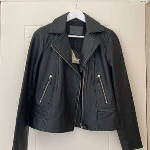 New Massimo Dutti black leather jacket with a tag size 38
