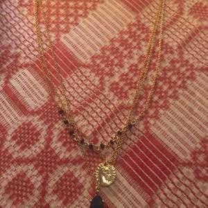 Nytt aldrig använt 3 i 1 halsband, guldfärg