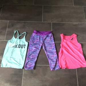 Ett rosa tränings linne och ett turkost tränings linne i storlek 134/140. Ett par korta tränings tights i storlek 134/140 men en söm där fram på högra benet är är av.