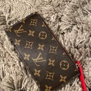 LV plånbok, röd insida