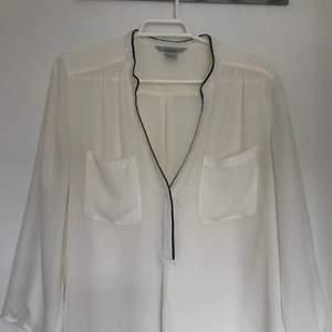 Semi transparent blouse, v neck with black details