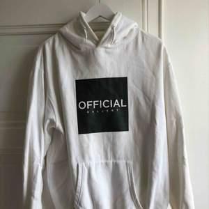 Vit hoodie från official gallery