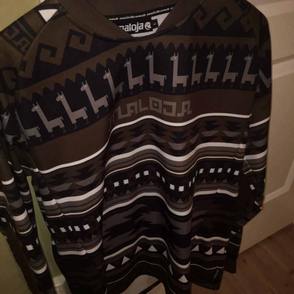 En oanvänd tröja från Maloja, nypris 800:-. Huvtröjor & Träningströjor.